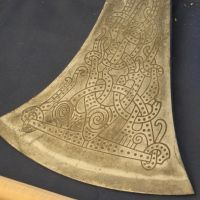 Etched axe blade by Reyphotos