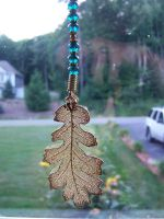Turquoise and Gold Elm Leaf Sun Catcher Close Up by RealLifeSuicideBlond