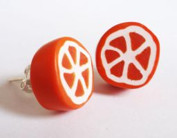 Orange slice earrings by FrozenNote