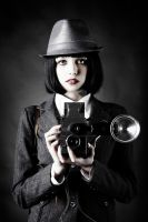 young woman and retro camera by Vladimir-Serov