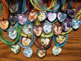 FOR SALE: Eeveelutions Glass Heart TCG Pendants by BlackManaBurning