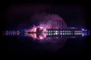 Factory at night by TheSlowSlowpoke