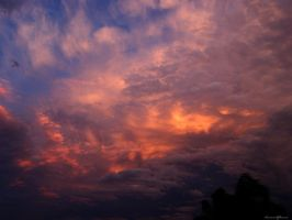Fire Behind the Clouds II by AwakenendByDreams