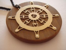 Dharma Wheel Pendant by jeanburgers