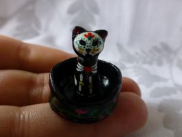 Tiny Day of the dead sugar skull cat in her bed by Actlikenaturedoes