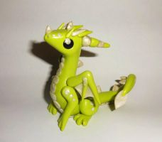 Yellow Dragon Sculpture by ByToothAndClaw