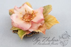 Withering flower brooch with rose hips by polyflowers