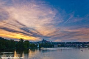 Sunset over Prague Castle by amrodel