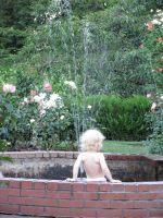Baby in Fountain by revenge-of-nerd-girl