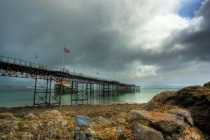 Mumbles pier in the rain by AngiWallace