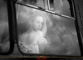 Girl in a window by Katkovskis