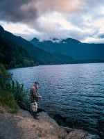 Fisherman, Lake Crescent by j-ouroboros