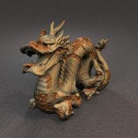 Rusting Stanford Dragon by fence-post