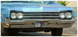 The Front Of An 1965 Oldsmobile Delta 88 by TheMan268