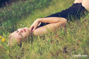 Beautiful woman lying on the field with her dreams by Faasteer