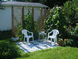 set of chairs in garden by mazoku-stock