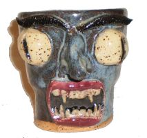Angry Blue Face Cup #3 by aberrantceramics