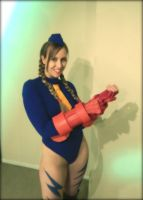Cammy - Putting on gauntlets by TheFineTrouble