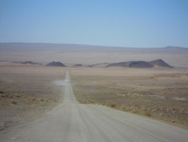 Desert road by Robinthedeviant
